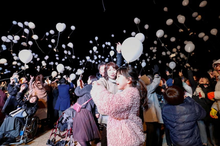 Revellers release balloons as they take part in New Year countdown event in Tokyo, Japan.