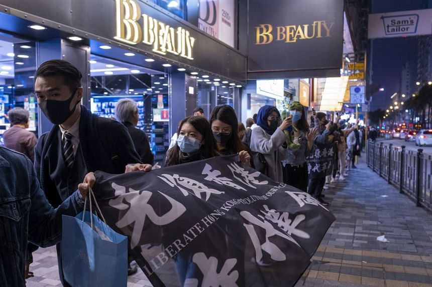 Demonstrators form a human chain during a protest on Nathan Road in the Tsim Sha Tsui district of Hong Kong.