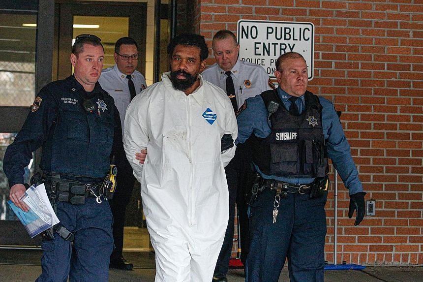 Grafton Thomas, the suspect in the Hanukkah celebration stabbings, leaving the Ramapo Town Hall in Airmont, New York, after his arrest on Sunday. The police officers who confronted and detained him found him covered with blood. Prosecutors said they