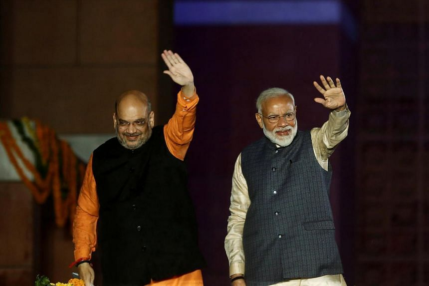 In this photo taken on May 23, 2019, Indian Prime Minister Narendra Modi and Bharatiya Janata Party President Amit Shah wave towards their supporters in New Delhi, India.