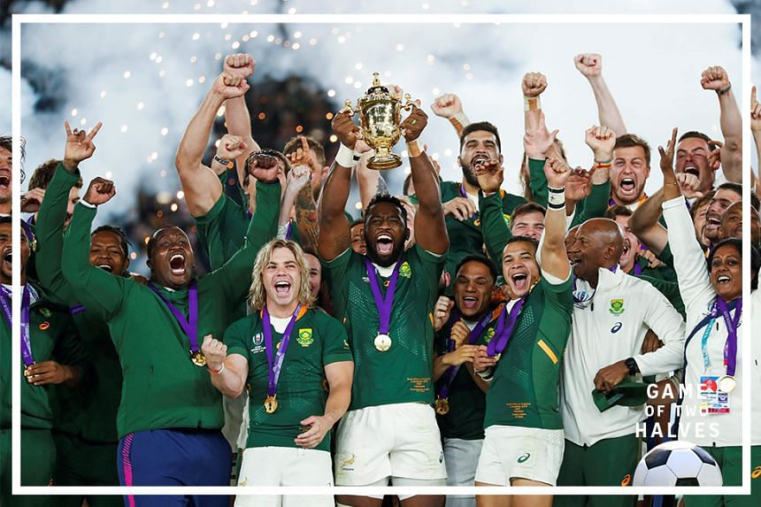South Africa's flanker Siya Kolisi (C) lifts the Webb Ellis Cup as they celebrate winning the Japan 2019 Rugby World Cup final match between England and South Africa at the International Stadium Yokohama in Yokohama on November 2, 2019.