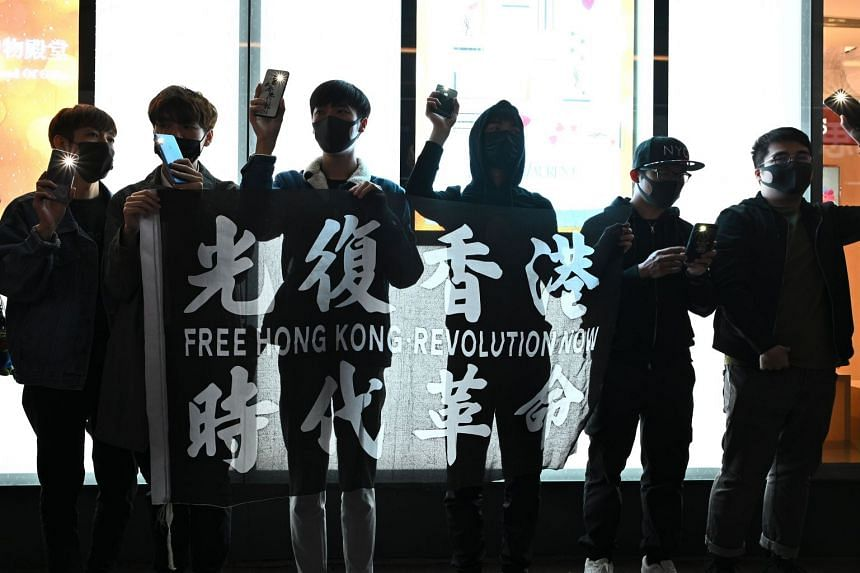 Pro-democracy protesters take part in a human chain rally in Hong Kong's Causeway Bay district.