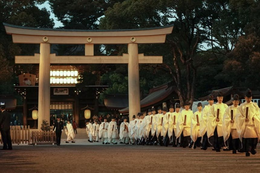 Shinto priests leave the inner shrine after concluding a ritual to mark the end of the year and prepare for the new one at Meiji Shrine in Tokyo, Japan, on Dec 31, 2019. People in Japan visit the shrine during the first three days of the year to pray