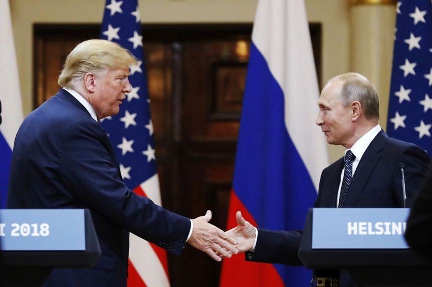 Trump (left) and Putin shake hands after their meeting in Helsinki, Finland, in 2018.