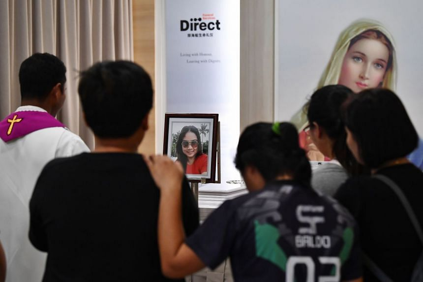 People pay their respects at the wake of Ms Abigail Danao Leste.