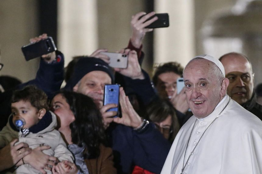 Pope Francis slaps at woman's hand after she latches onto him