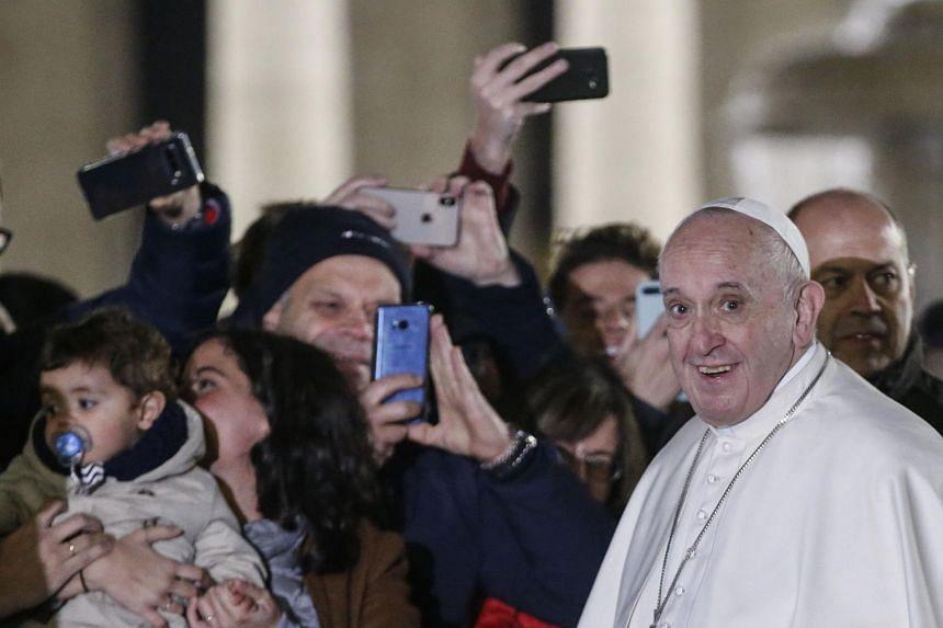 Pope Francis visits the crib at the Vatican City, Dec 31, 2019.