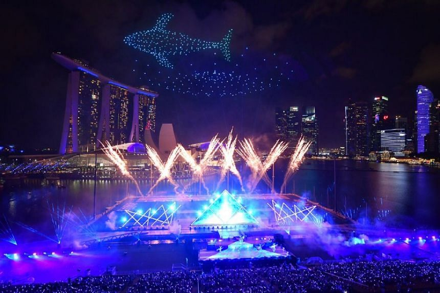Drones forming the shape of a whale with Star Island fireworks during the countdown.