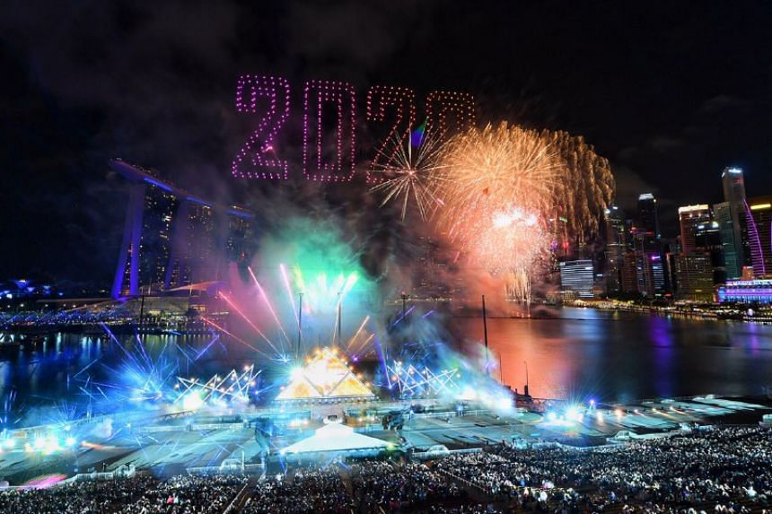 """Drones forming the numbers """"2020"""" with Star Island fireworks during the countdown."""