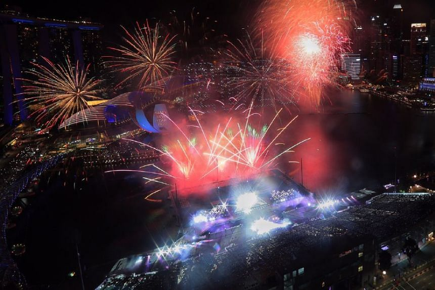 Drones forming '2020' as fireworks go off.