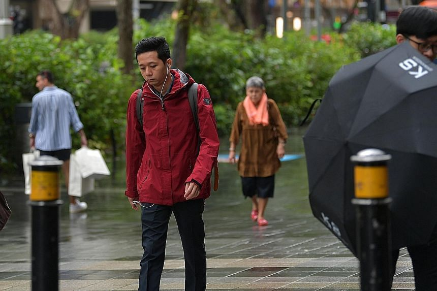 The year-end cold spell that saw some reaching for their sweaters and scarves last month is forecast to continue this month, the National Environment Agency's Meteorological Service Singapore said yesterday. ST PHOTO: JOYCE FANG