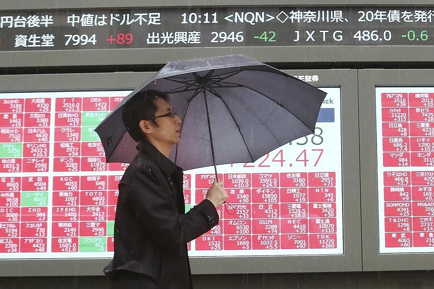 An electronic stock board of a securities firm in Tokyo in December. Except for Malaysia, which ended the year in the red, the rest of Asia's share markets stayed in the black after hopes of a United States-China trade war truce helped erase losses i