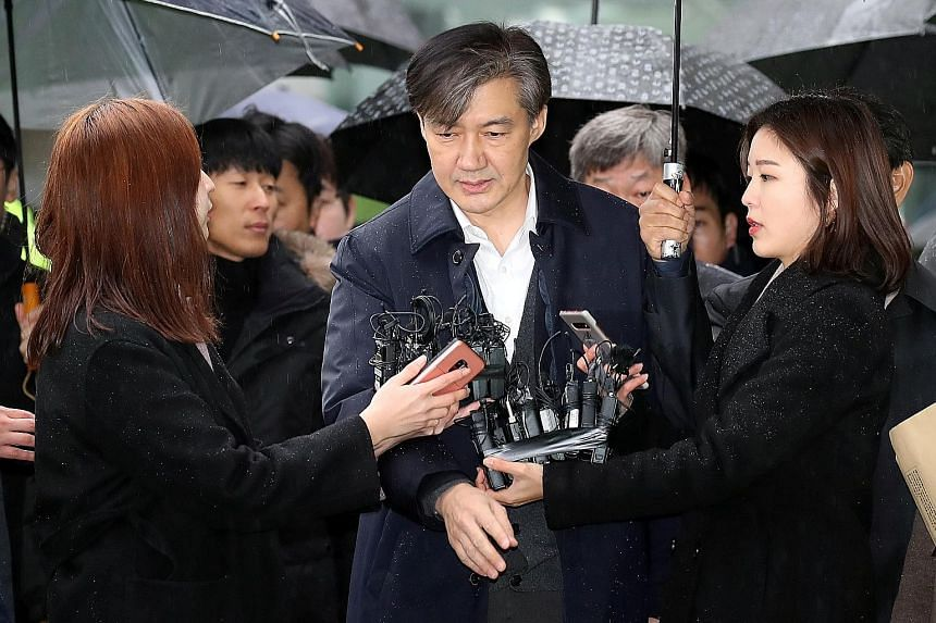 South Korea's former justice minister Cho Kuk arriving at a Seoul court for a hearing last week. He and his wife, Chung Kyung-shim, are being prosecuted for falsifying documents regarding family investments and their children's university admissions.