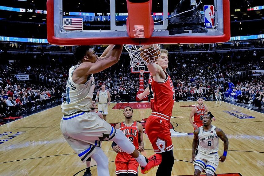 Giannis Antetokounmpo dunking against Bulls' Lauri Markkanen. The Bucks star scored some flashy baskets on his return from injury. PHOTO: ASSOCIATED PRESS