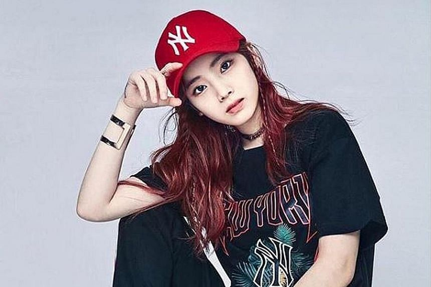 SINGER'S PASSPORT DETAILS EXPOSED: The security team had no trouble shielding the members of girl group Twice from fans at Seoul's Gimpo airport on Sunday. But the team could not prevent the passport details of singer Dahyun (above) from being filme