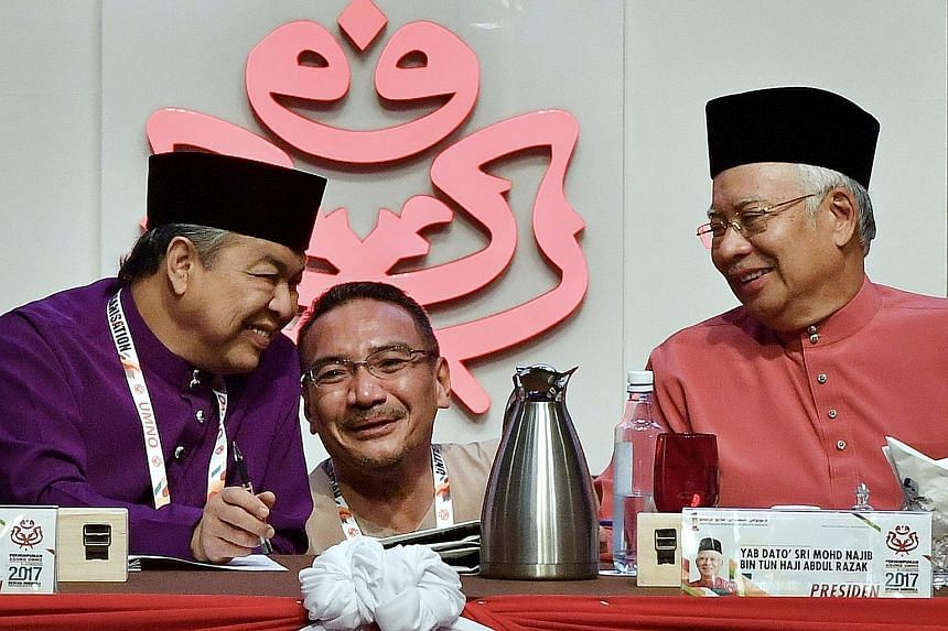 Above: Umno disciplinary board chief Mohamed Apandi Ali quit in anger after a disciplinary meeting was postponed. Right: A 2017 file photo of then Prime Minister Najib Razak with Umno president Ahmad Zahid Hamidi and vice-president Hishammuddin Husse