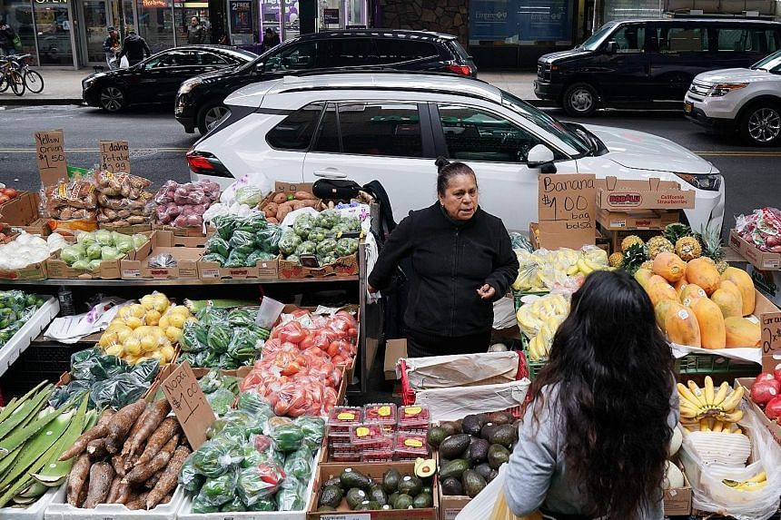 Street vendors in New York City sell a variety of things, from tamales (above) to produce (right). Many of these vendors are undocumented migrants and face a litany of problems while on the job, from bad weather to arrests.