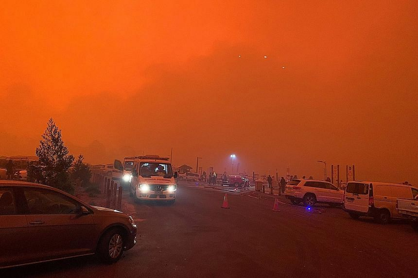 """The sky glowing as bush fires raged near Mallacoota town, in Victoria state, yesterday. The authorities said nearby fires were causing extreme thunderstorms and """"ember attacks"""". PHOTO: REUTERS"""