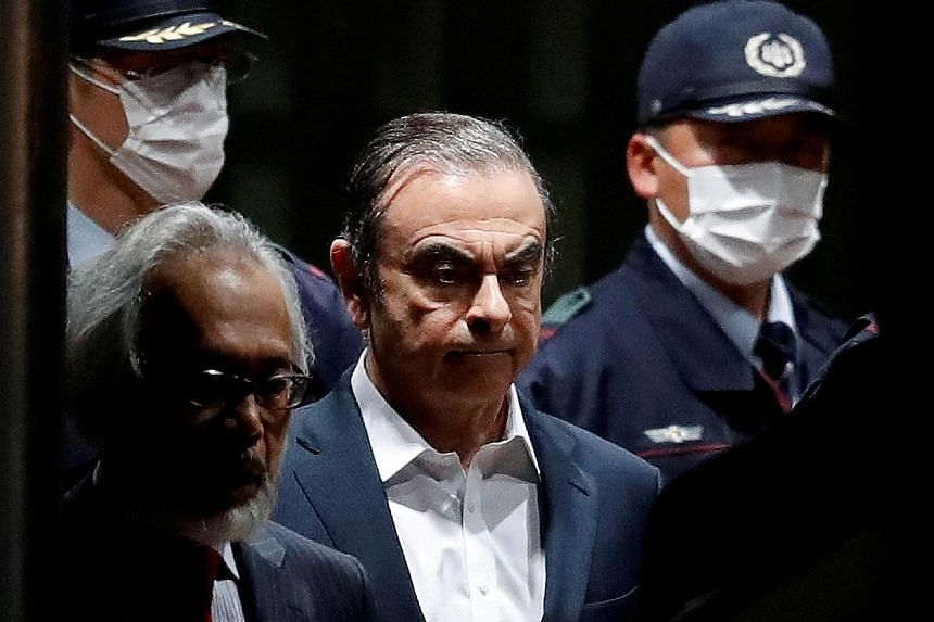 Sacked Nissan chairman Carlos Ghosn leaving the Tokyo Detention House in April last year. He faces four charges - which he denies - including hiding income and enriching himself through payments to dealerships in the Middle East.