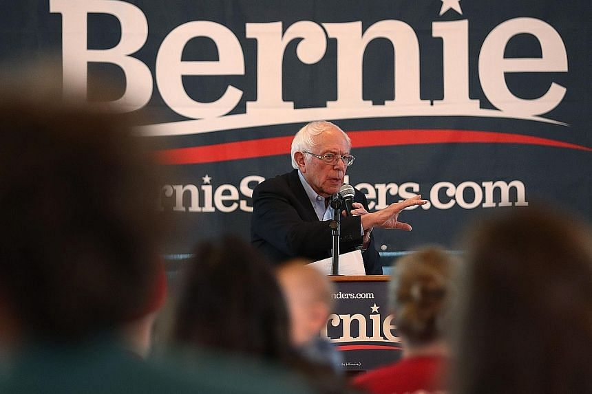 Mr Bernie Sanders, another Democratic presidential hopeful, has been given the all-clear from his doctors following a heart attack. PHOTO: ASSOCIATED PRESS Mr Joe Biden, a contender for the Democratic Party's presidential nomination, with a supporter