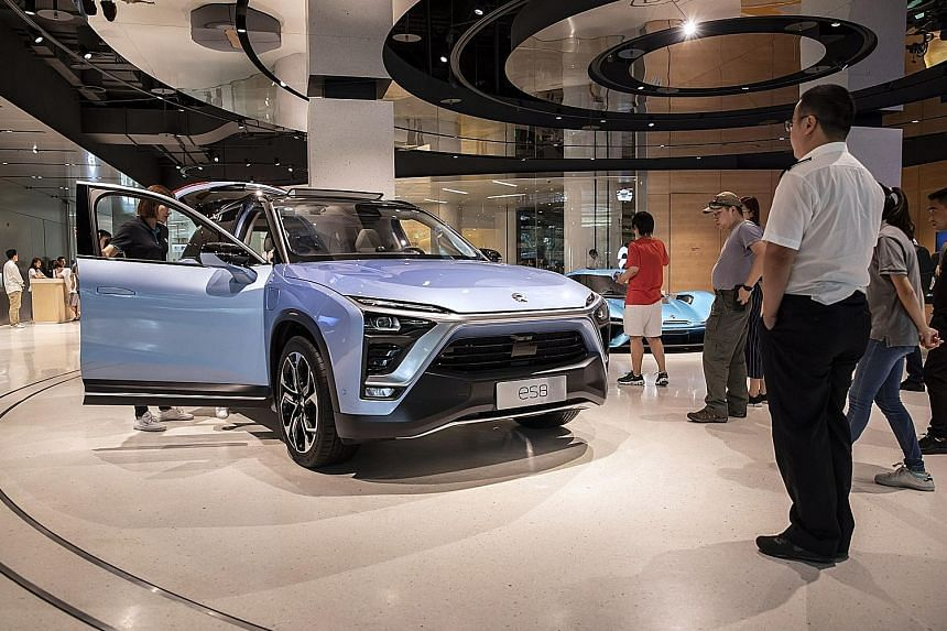 NIO Total debt to total equity: 2,354% WYNN MACAU Total debt to total equity: 1,421% A Nio ES8 vehicle on display in Shanghai in 2018. The Chinese electric vehicle maker is among firms with high leverage in the region. Firms domiciled in Macau such a