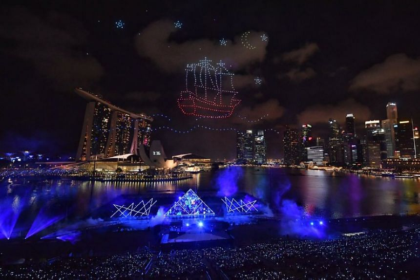 Drones form the shape of a ship during the countdown.
