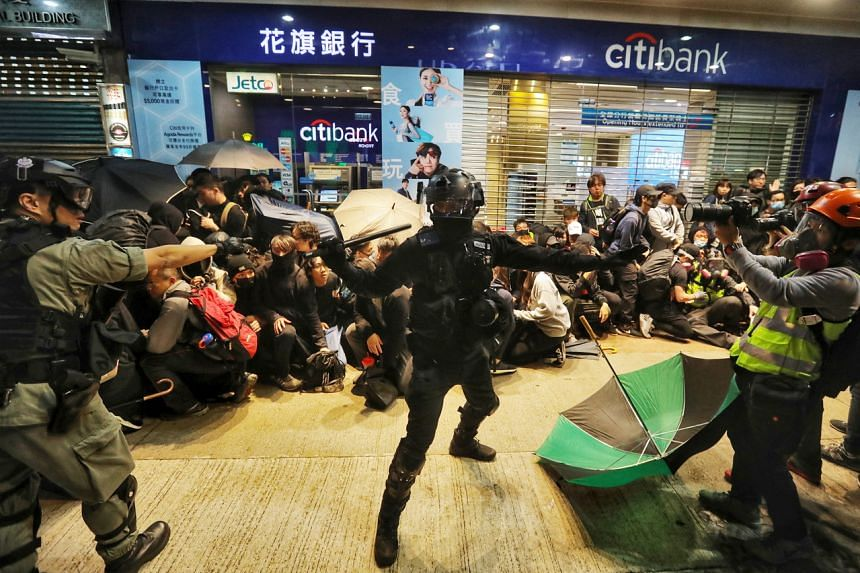 Riot police detain protesters in Hong Kong on Jan 1, 2019.