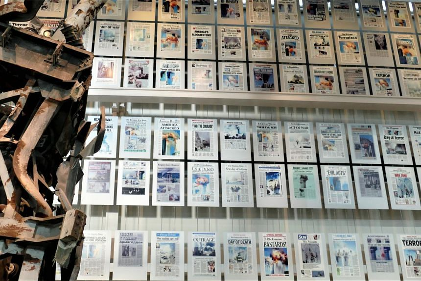 9-11 front pages, with wreckage from twin towers, at the Newseum in Washington.