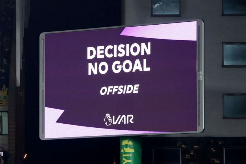 A VAR review message is seen during a match between Norwich City and Tottenham Hotspur.