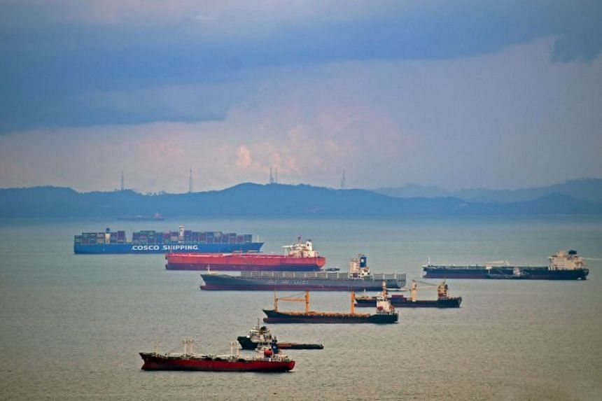 Container ships in the Singapore Strait in July 2019.