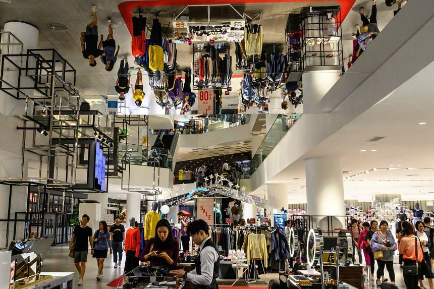 Shoppers at a Bangkok mall on Boxing Day. Trade tensions, a strong baht and political risks have hit growth. Thailand's central bank predicts growth of just 2.5 per cent last year, the weakest since 2014.