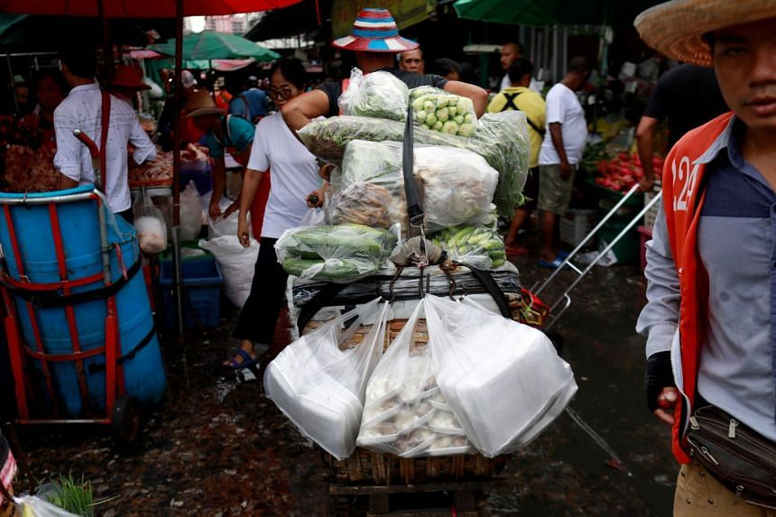 A photo taken on June 19, 2019, shows plastic bags being used at a market in Bangkok.