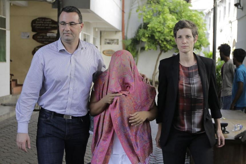 A photo taken on Dec 30, 2019, shows Swiss embassy employee Garnier Banister Francis (centre) leaving a court in Colombo after she was granted bail.