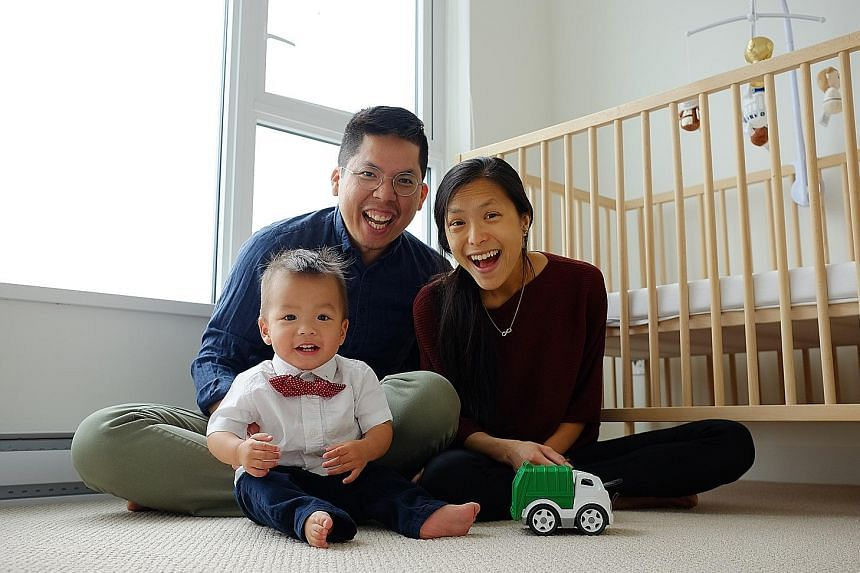 Mr Stanley Lai and Mrs Cheryln Lai with their son Jonah, who will turn two years old next month, in their home in British Columbia, Canada. Jonah is among the 1,576 children born overseas to Singaporean parents and granted Singapore citizenship in 20