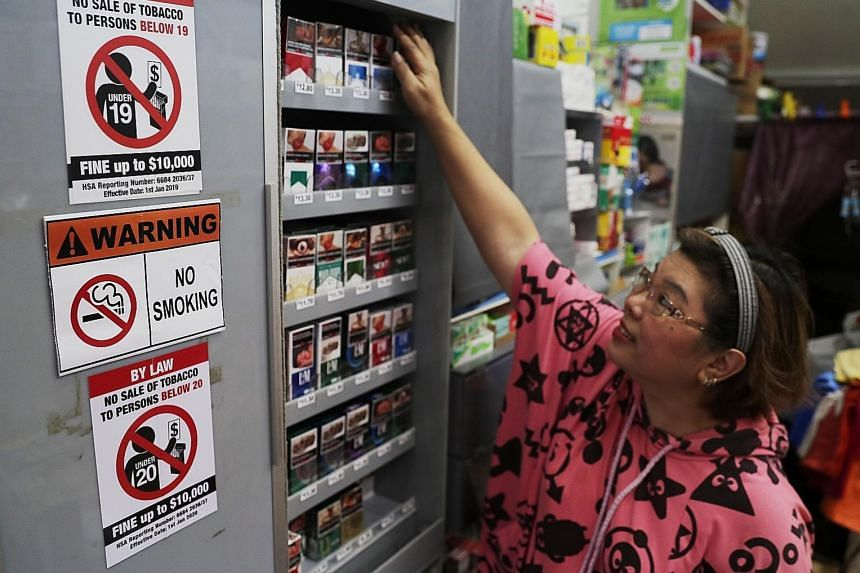 Madam Sherley Ang, 54, owner of Hianky Provision Store, which displays both the new and old notices on the minimum legal age for purchasing tobacco. ST PHOTO: KELVIN CHNG