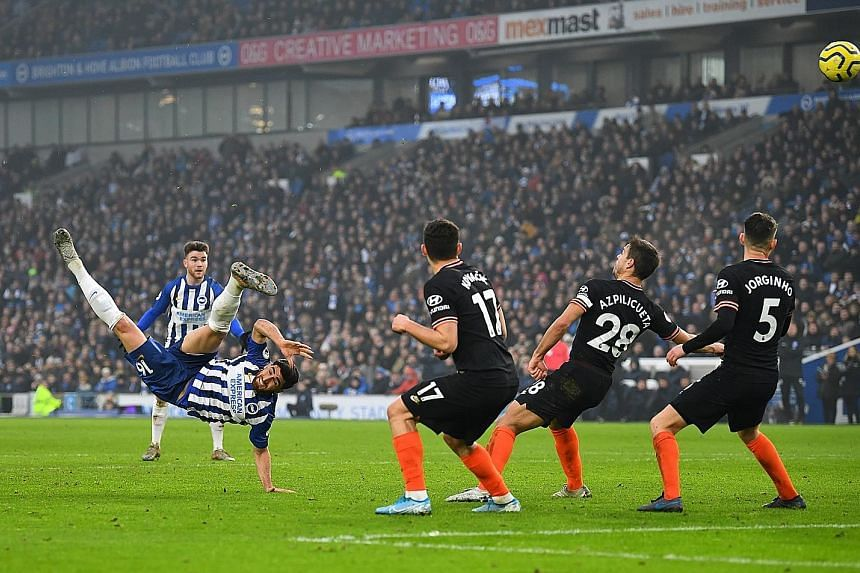 Brighton's Alireza Jahanbakhsh showing great technique and athleticism to score the equaliser in the 1-1 Premier League draw with Chelsea at the Amex Stadium yesterday. It was the second straight game in which he scored. PHOTO: REUTERS