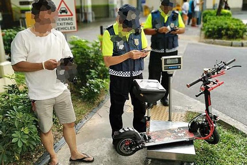 Above: LTA enforcement officers caught this rider using his device on a footpath in Yishun. Right: Officers doing their checks outside Compass One mall in Sengkang, one of the areas which they were patrolling yesterday. ST PHOTO: GIN TAY