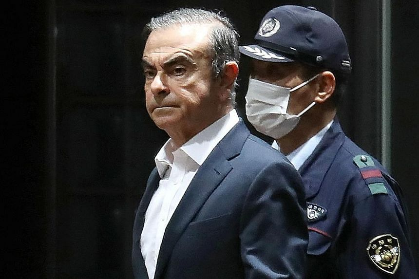 It is still not clear how Carlos Ghosn was able to leave Japan and flee to Lebanon without any of his passports. PHOTO: AGENCE FRANCE-PRESSE Private security guards seen on Tuesday outside the Beirut home of former Nissan boss Carlos Ghosn. By leavin