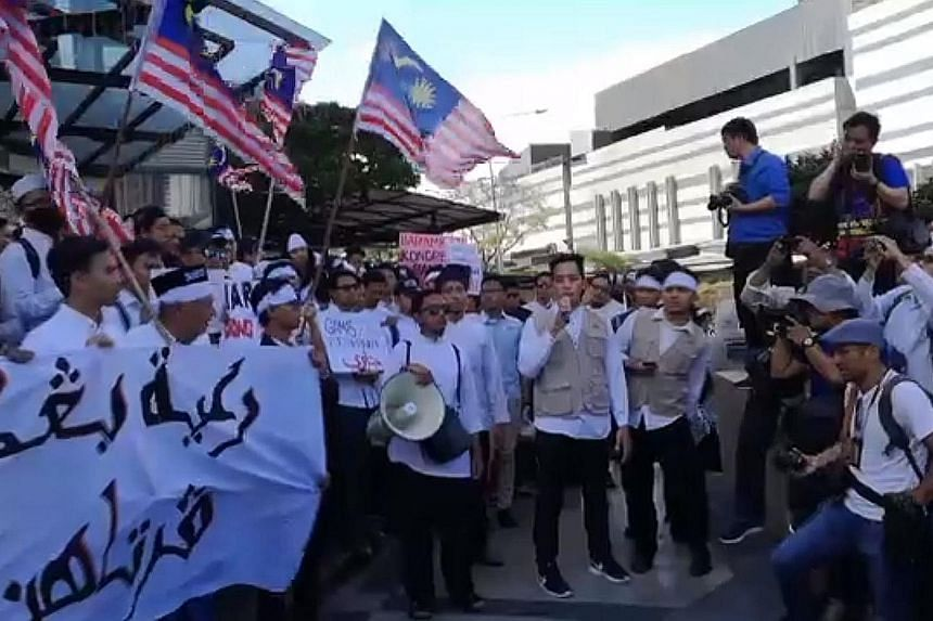 Organised by the Malaysian Muslim Students Coalition (Gamis), the peaceful gathering yesterday was held despite a police warning that the organiser had failed to obtain a permit for the march. PHOTO: GAMISMALAYSIA/FACEBOOK
