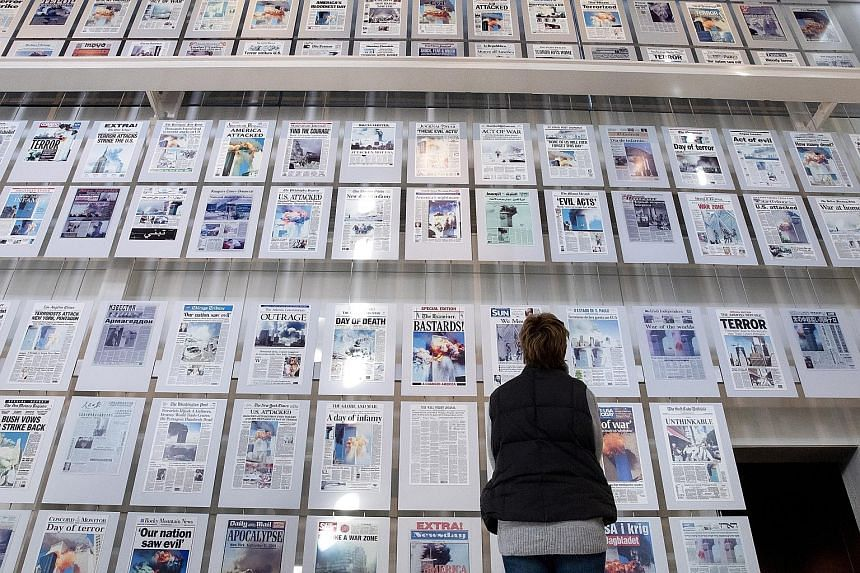 The front pages of American newspapers the morning after the Sept 11, 2001, terrorist attacks, on display at the Newseum in Washington. The bespoke museum of journalism and the media shut its doors for the last time on Tuesday as it could not make en