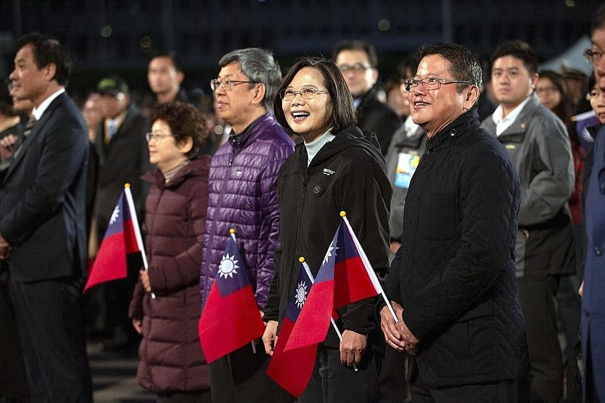 President Tsai Ing-wen (front row, second from right) at a New Year's Day event in Taipei yesterday. She cited the protests in Hong Kong as proof that what Beijing proposes for the island is untenable. She is favoured to win a second term during elec