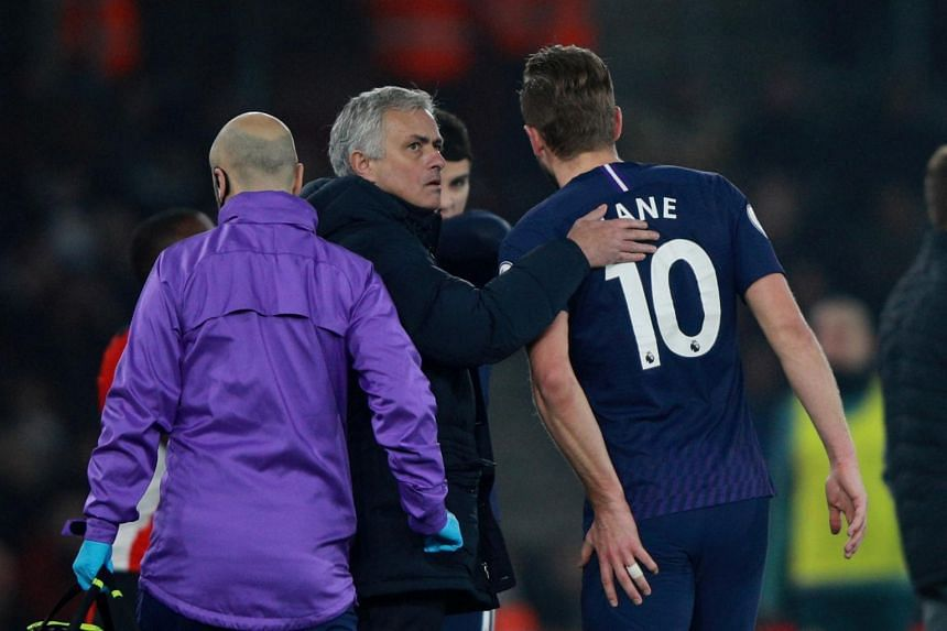 Tottenham Hotspur manager Jose Mourinho (centre) with Harry Kane who was injured in the match against Southampton.