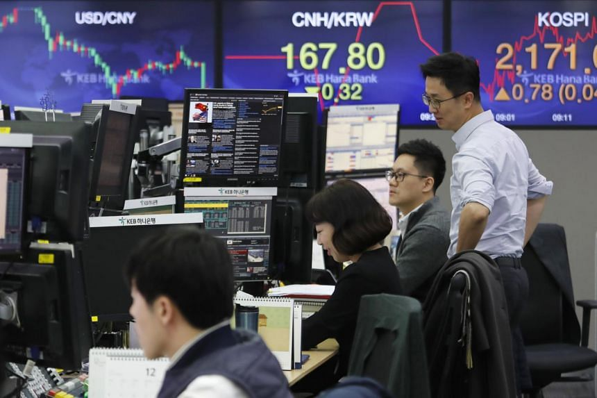 Currency traders working at the foreign exchange dealing room of a bank in Seoul, South Korea, on Dec 16, 2019.