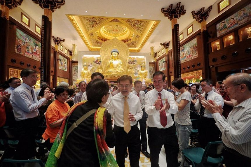 DPM Heng Swee Keat greeting a devotee at the Singapore Buddhist Lodge's 85th anniversary celebration on Jan 2, 2020.