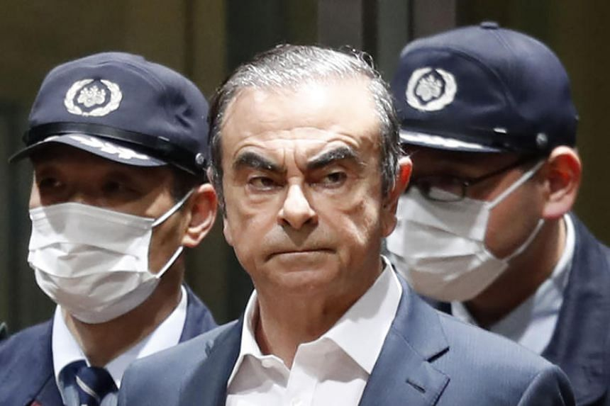 In a photo taken on April 25, 2019, former Nissan Chairman Carlos Ghosn leaves Tokyo's Detention Centre for bail in Tokyo.