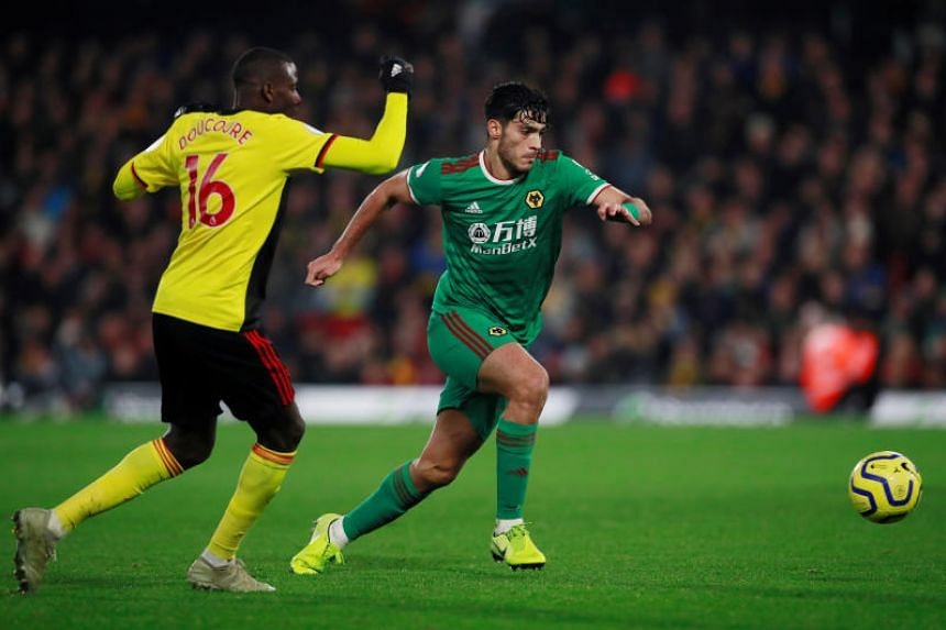 Wolverhampton Wanderers' Raul Jimenez in action with Watford's Abdoulaye Doucoure during their EPL match on Jan 1, 2020.