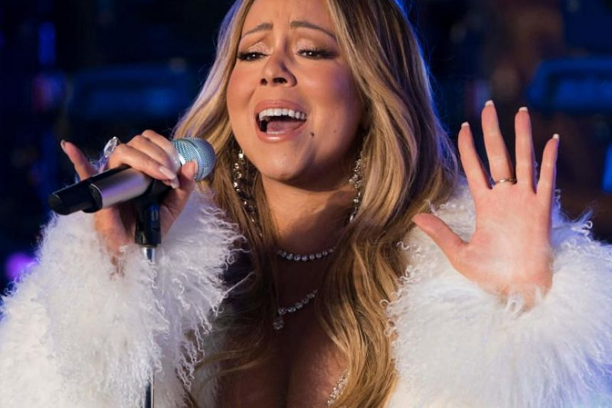 "Mariah Carey's classic holiday song ""All I Want For Christmas Is You"" has helped her make history as the first artist to top the Billboard charts in four separate decades."