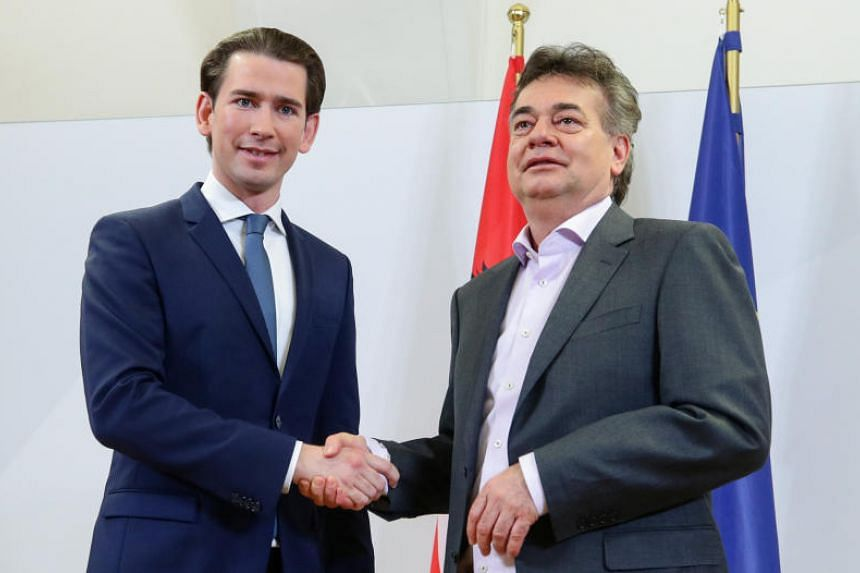Head of Austria's People's Party Sebastian Kurz (left) and leader of the Green Party Werner Kogler shake hands after delivering a statement, in Vienna, on Jan 1, 2020.