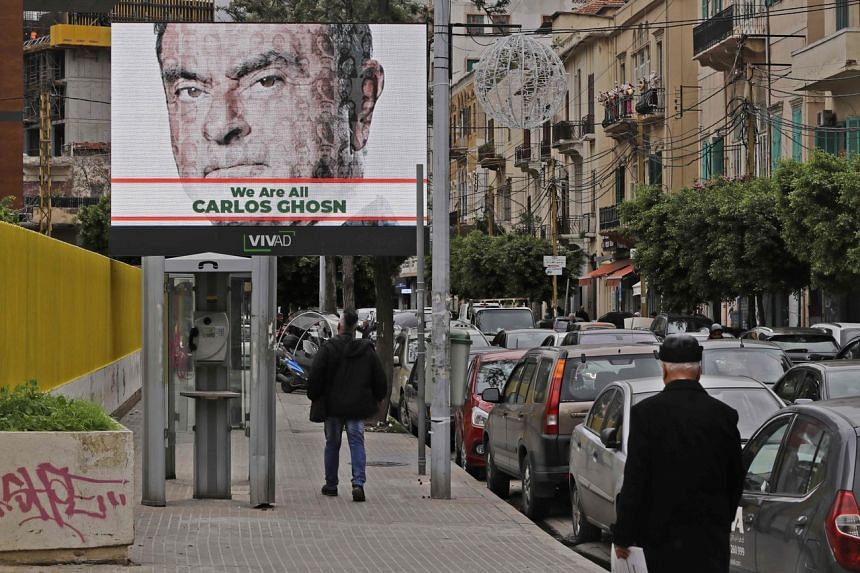 A photo taken on Dec 6, 2018, shows a publicity billboard in support of ousted Nissan chairman Carlos Ghosn on a street in Beirut.