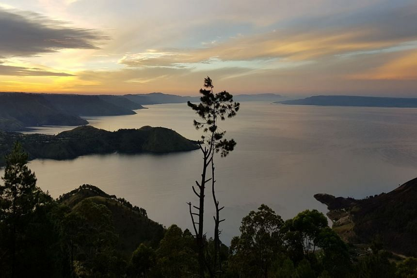 Covering more than 1,200 sq km, Lake Toba offers a myriad of things to do such as visiting Batak villages, climbing dormant volcanoes and exploring the tallest waterfall in Indonesia. PHOTO: J_SIE74 FROM PIXABAY